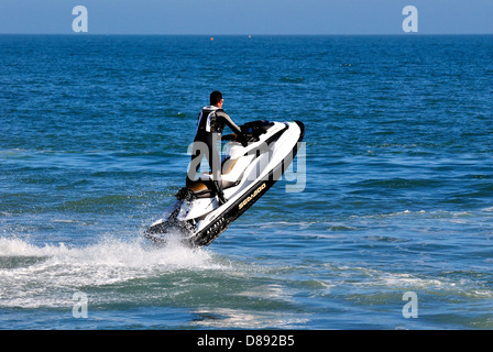 Man riding a jetski Dorset england uk - Stock Photo