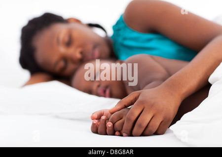 loving-african-mother-napping-with-baby-