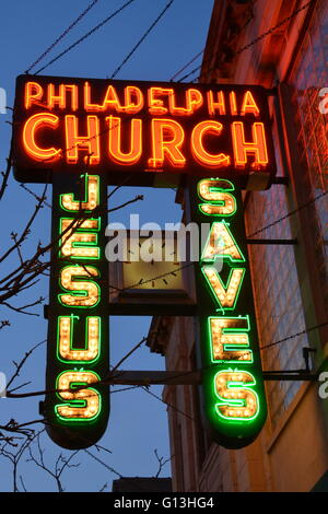 The 1940 neon sign to the Philadelphia Church on Chicago's north side Andersonville neighborhood in a former bank - Stock Photo
