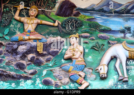 Wat Inpeng buddhist temple.  Painting depicting the life story of Shakyamuni Buddha. Vientiane. Laos. - Stock Photo