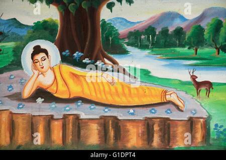 Painting depicting the life story of Shakyamuni Buddha. Reclining Buddha.  Vang Vieng. Laos. - Stock Photo