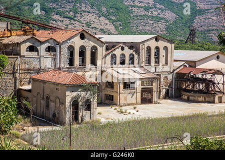 Industrial buildings and machine of abandoned Mine of Montevecchio in Sardinia, Arbus, Guspini, Italy - Stock Photo