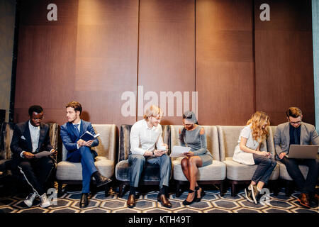 Business people waiting for job interview, talking - Stock Photo